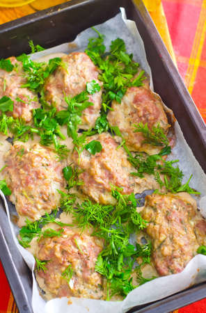 Baked meat balls with the greens photo