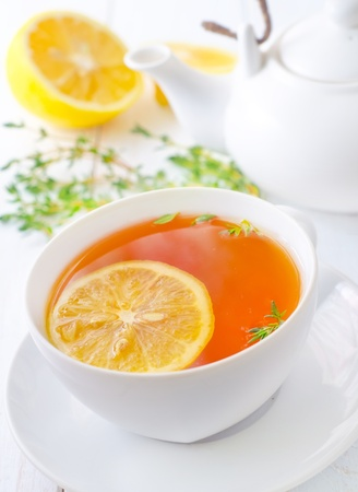 Fresh tea with lemon in the white cup photo