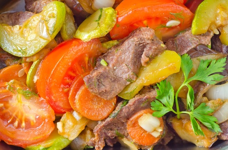 baked meat with vegetables photo