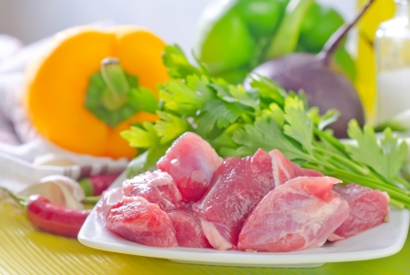 uncooked bacon: meat and vegetables Stock Photo