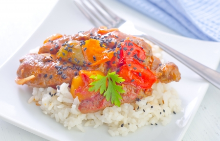 boiled rice with meat and vegetables photo