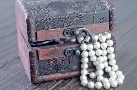 perl: Old wooden chest with perl Stock Photo