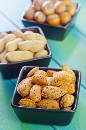 nuts in black bowls photo