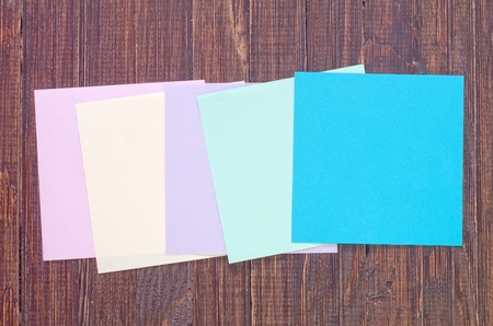 color paper on wooden background photo