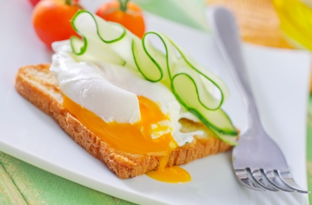 toast with poached eggs photo