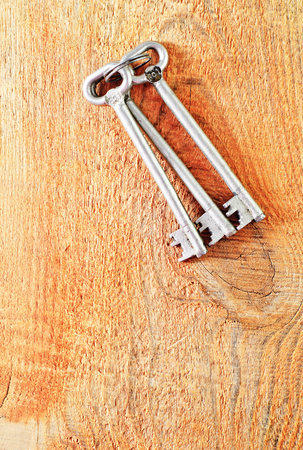 key on wooden background photo