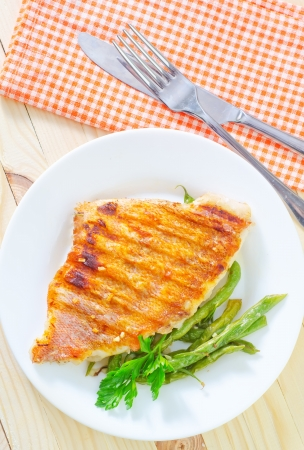 fried fish with green beans photo