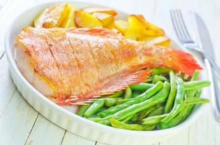 white salmon river: fried fish, potato and green beans Stock Photo