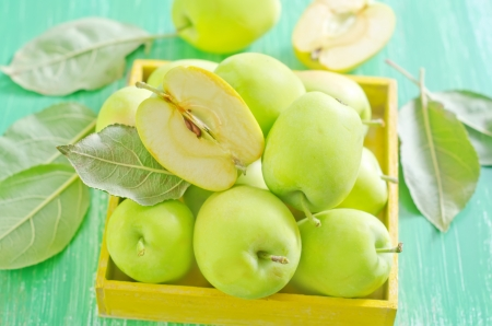 fresh apples in yellow box photo