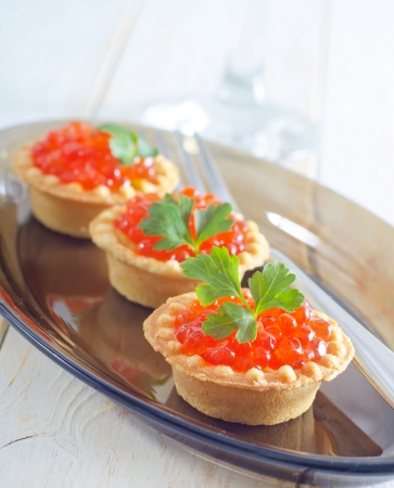 tartalets con caviar photo