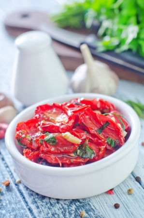 dry tomatoes with oil and basil photo