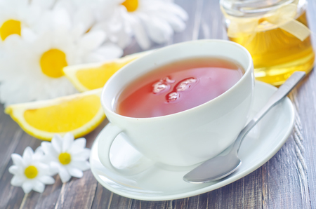 Tea with lemon and honey photo
