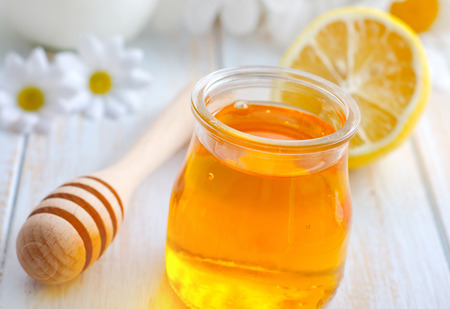 brown sugar: fresh honey in the glass bank and camomiles