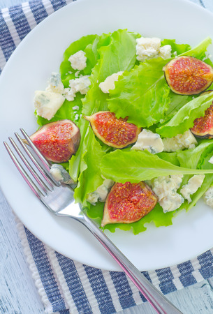 blue cheese and figs on plate photo