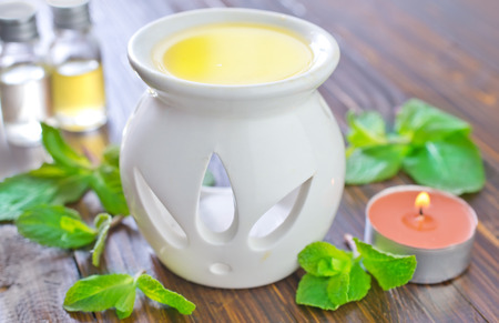perfumed candle: aroma oil Stock Photo