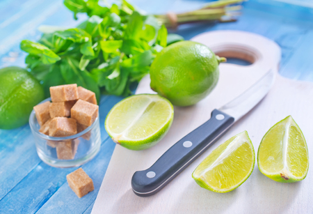 fresh limes with sugar and mint photo