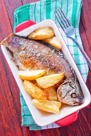 baked fish and potato photo