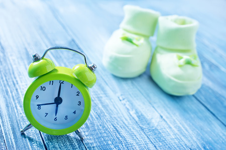 clock and baby socks Stock Photo