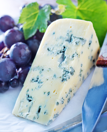 cheeseboard: cheese and grape Stock Photo