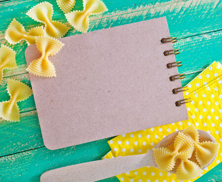 raw pasta with notepad  photo
