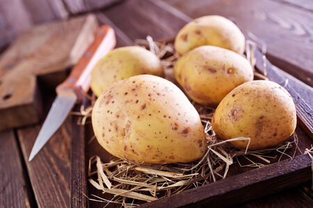 raw potato: raw potato in wooden box and on a table