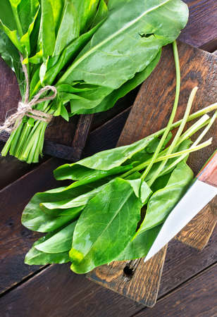 wood sorrel: fresh sorrel on the wooden board and on a table