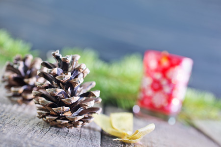 pinecones and christmas candle on a table photo