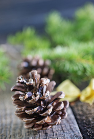 pinecones and christmas decoration on a table photo