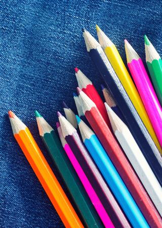 textille: color pencils on the jeans textille