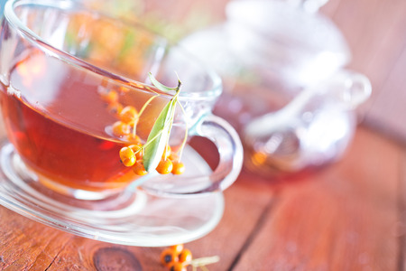 stimulated: tea in glass cup on the wooden table