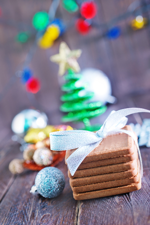 christmas cookies and decoration on the wooden table photo