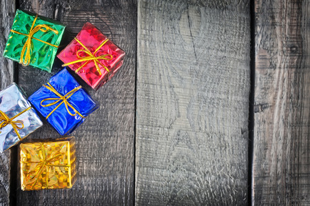 color presents, christmas presents on a table photo