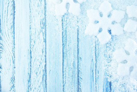 snowfolk and snow on white wooden background photo