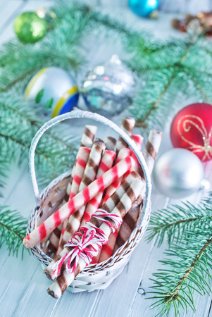 Christmas candy, Christmas treats and a branch of the Christmas tree photo