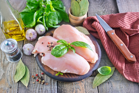 raw chicken fillet on the wooden table