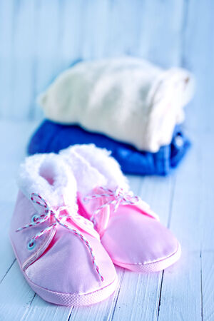 baby clothes on a table, clothes for little baby girl photo