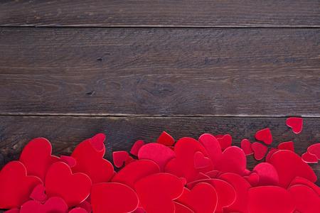 heart symbol: red hears on the wooden table, hearts on wood Stock Photo