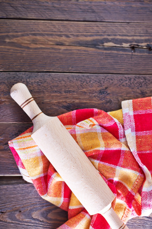 bird s house: wooden rolling pin and napkin on a table