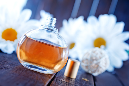 Perfume in bottle on the wooden table photo
