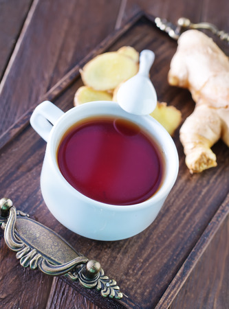tea with ginger in cup and on a table photo