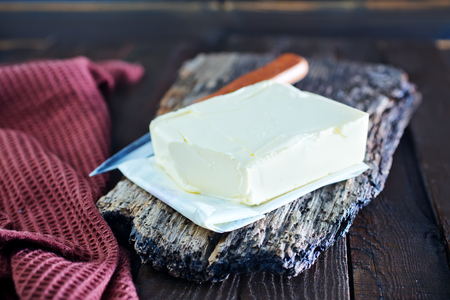 butterfat: butter on wooden board and on a table