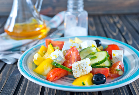heathy diet: fresh greek salad on plate and on a table