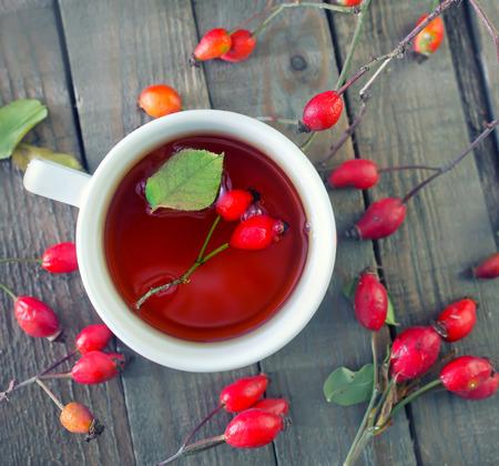 fresh tea with rosehip on a table photo