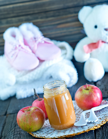 baby food in bank and on a table Stock Photo