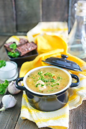 pea soup with croutons on the wooden table photo
