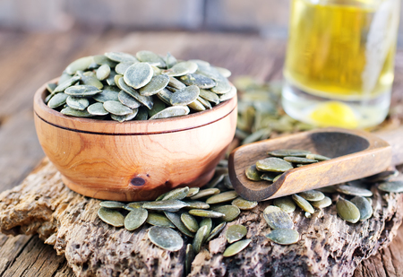 pumpkin seed: pumpkin seed in bowl and on a table Stock Photo