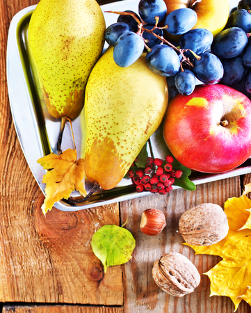 autumn harvest on the wooden background, fruits and vegetables photo