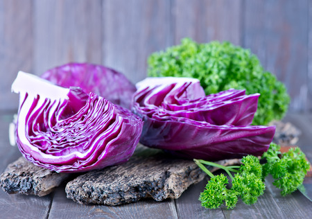appetize: blue cabbage on board and on a table