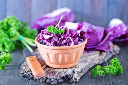 appetize: blue cabbage in bowl and on a table