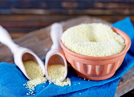 kuskus: cous-cous in bowl and on a table Stock Photo